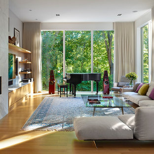 Inspiration for a large contemporary formal and open concept light wood floor living room remodel in Toronto with beige walls, a ribbon fireplace and a wall-mounted tv