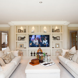 Traditional formal enclosed living room in Berkshire with beige walls, carpet and a wall mounted tv.