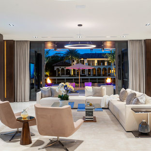 This is an example of a large modern open plan living room in Miami with brown walls, marble flooring, a ribbon fireplace, a stone fireplace surround, a wall mounted tv and white floors.