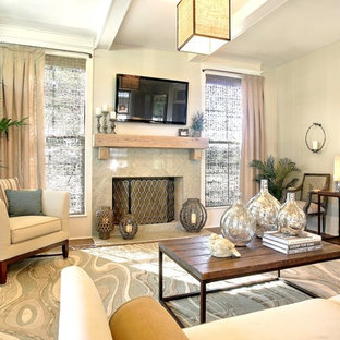 Contemporary living room in New Orleans with a standard fireplace and a wall mounted tv.