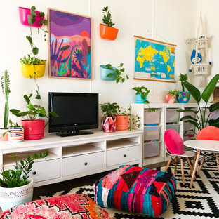 Photo of an eclectic living room in Melbourne with white walls and a freestanding tv.