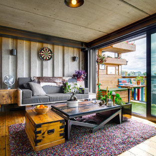 Inspiration for an eclectic living room in Essex with grey walls and medium hardwood flooring.