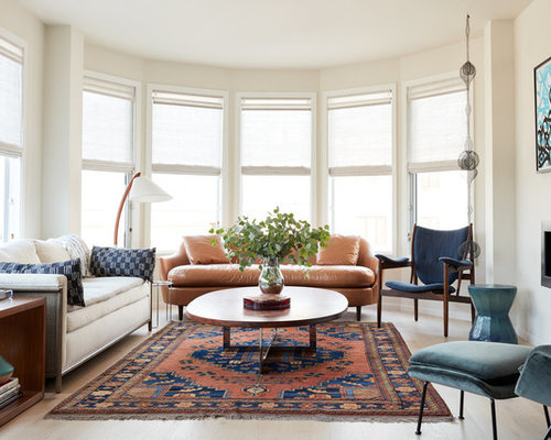 Example Of A Trendy Light Wood Floor Living Room Design In San Francisco  With Beige Walls