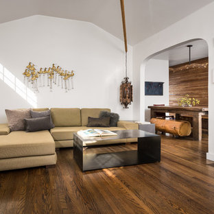 Living room - small contemporary open concept medium tone wood floor and brown floor living room idea in Los Angeles with white walls, a standard fireplace, a plaster fireplace and no tv