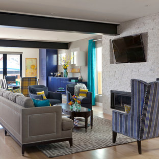 Inspiration for a contemporary living room in Denver with grey walls, light hardwood flooring, a ribbon fireplace and a stone fireplace surround.