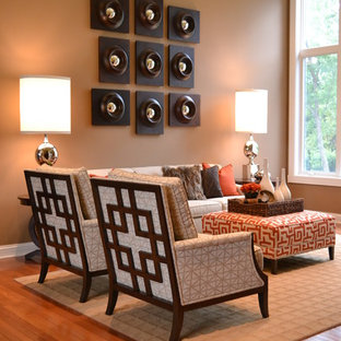 This is an example of a classic living room in Indianapolis with brown walls.