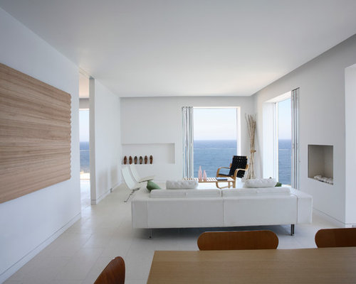 Photo Of A Modern Enclosed Living Room In Sydney With White Walls Standard Fireplace