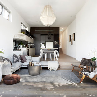Inspiration for a small contemporary open concept living room in Sydney with white walls, light hardwood floors and brown floor.