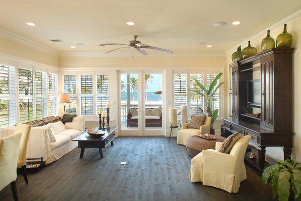 Tropical Living Room by JMA INTERIOR DECORATION