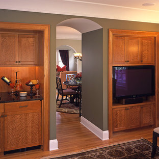 This is an example of a medium sized contemporary enclosed living room in Minneapolis with green walls, medium hardwood flooring, a home bar, no fireplace and a built-in media unit.