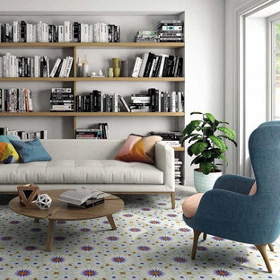 Mediterranean open plan living room in Other with porcelain flooring and blue floors.