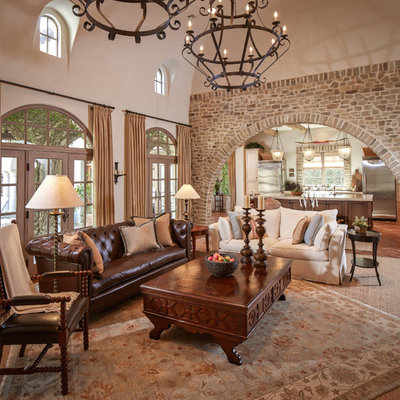 Mid-sized tuscan formal and enclosed terra-cotta tile and red floor living room photo in Houston with beige walls, no fireplace and no tv