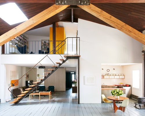 Inspiration For An Industrial Loft Style Gray Floor And Painted Wood Floor  Family Room Remodel