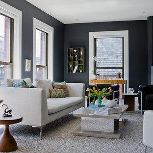 ボストンの中サイズのトランジショナルスタイルのおしゃれな独立型リビング (テレビなし、フォーマル、淡色無垢フローリング、コンクリートの暖炉まわり、グレーの壁、標準型暖炉) の写真