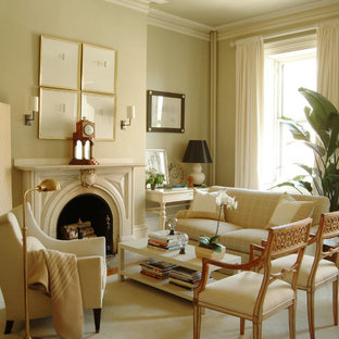 Inspiration for a timeless formal medium tone wood floor and beige floor living room remodel in Los Angeles with green walls and a standard fireplace