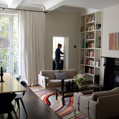 Inspiration for a modern open concept living room remodel in Boston with beige walls and a standard fireplace