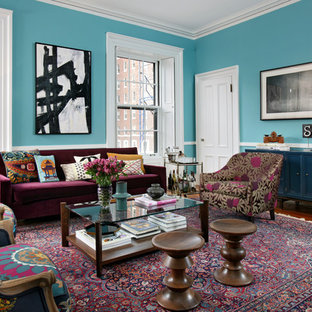 Living room - eclectic living room idea in Boston with blue walls