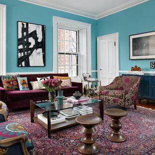 Exempel på ett eklektiskt vardagsrum, med blå väggar