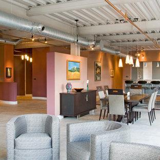 Esempio di un ampio soggiorno industriale stile loft con camino sospeso, cornice del camino in metallo, pareti multicolore, pavimento in travertino, TV a parete, sala formale e pavimento beige