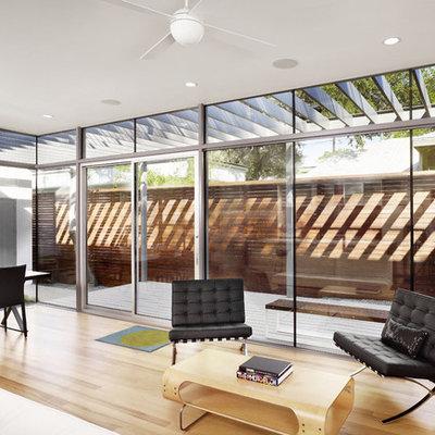 Inspiration for a modern light wood floor living room remodel in Austin
