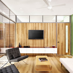 Photo of a medium sized modern living room in Austin with a wall mounted tv.