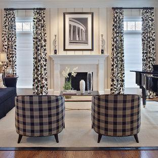 Idéer för ett modernt vardagsrum, med ett musikrum, beige väggar och en standard öppen spis