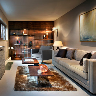 Design ideas for a medium sized contemporary enclosed living room in London with brown walls and grey floors.
