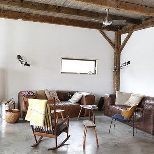 Living room - rustic concrete floor living room idea in New York