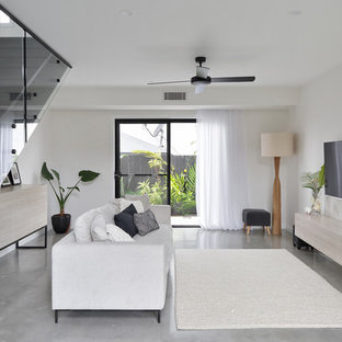 Mid-sized contemporary living room in Sunshine Coast with white walls, concrete floors and grey floor.