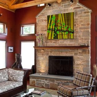 ボルチモアのラスティックスタイルのおしゃれなリビング (赤い壁、標準型暖炉) の写真