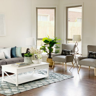 Design ideas for a transitional living room in Melbourne with white walls, medium hardwood floors and brown floor.