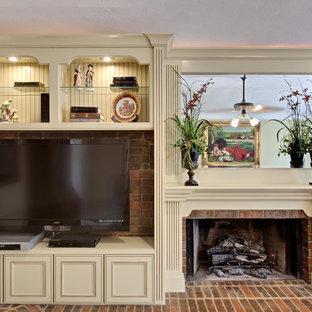 アトランタの広いトラディショナルスタイルのおしゃれなリビング (フォーマル、カーペット敷き、標準型暖炉、木材の暖炉まわり、壁掛け型テレビ、ベージュの床) の写真