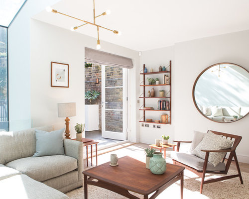 Example Of A 1960s Light Wood Floor Living Room Design In London With White Walls