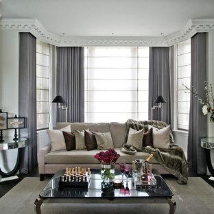 Idée de décoration pour un salon tradition avec un mur gris, un sol en bois foncé et une cheminée standard.