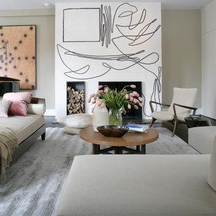 Foto di un soggiorno moderno con sala della musica e pareti beige