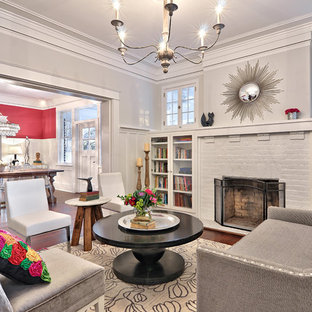 Photo of an arts and crafts formal living room in Austin with grey walls, a standard fireplace, a brick fireplace surround, dark hardwood floors and no tv.