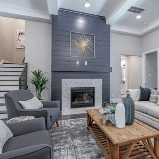 Huge transitional open concept dark wood floor, coffered ceiling and shiplap wall living room photo with white walls, a standard fireplace and a shiplap fireplace