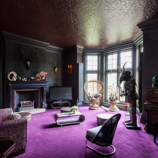 Inspiration for an eclectic carpeted living room remodel in London with black walls and a standard fireplace