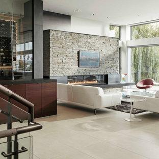 シアトルの大きいモダンスタイルのおしゃれなLDK (フォーマル、白い壁、磁器タイルの床、横長型暖炉、石材の暖炉まわり、テレビなし、白い床) の写真