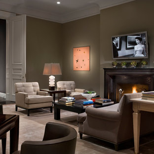 Classic formal enclosed living room in New York with brown walls, carpet, a standard fireplace, a wooden fireplace surround and a wall mounted tv.