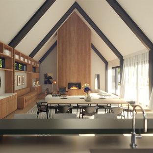 Foto de salón abierto y abovedado, moderno, grande, con suelo de madera clara, chimenea tradicional y marco de chimenea de madera