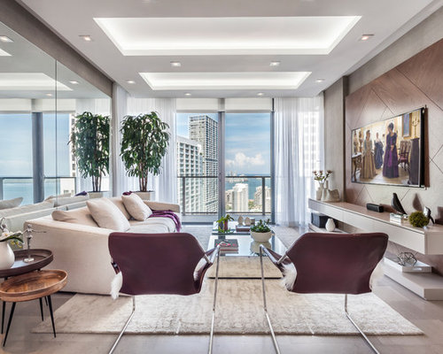Example of a trendy gray floor living room design in miami with gray walls and a