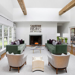 Living room - transitional formal and open concept medium tone wood floor living room idea in New York with white walls and a standard fireplace