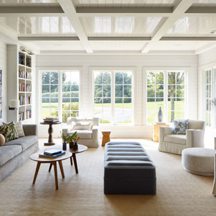 Living room library - coastal coffered ceiling, shiplap ceiling and shiplap wall living room library idea in New York with white walls and no tv