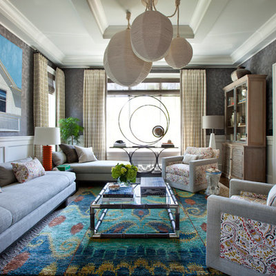 Inspiration for an eclectic formal carpeted living room remodel in New York with gray walls