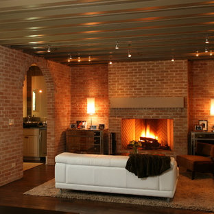 Trendy living room photo in Austin with a brick fireplace