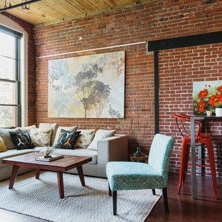 Esempio di un soggiorno industriale aperto con pareti rosse e parquet scuro