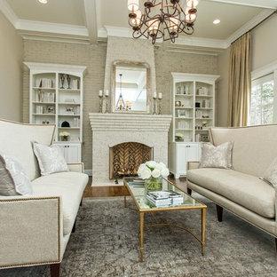 Idee per un soggiorno contemporaneo di medie dimensioni con cornice del camino in mattoni, sala formale, pareti beige, parquet scuro, camino classico e nessuna TV