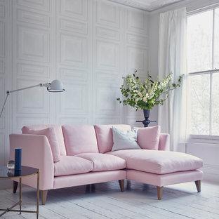 ロンドンの小さいコンテンポラリースタイルのおしゃれなリビング (ライブラリー、白い壁、塗装フローリング、白い床) の写真