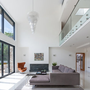 Inspiration for a medium sized contemporary open plan living room in Other with white walls, no tv and white floors.